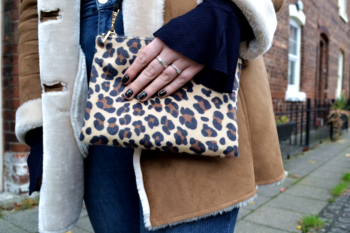 trend editorial shearling sheepskin jacket how to style aw16 manchester nail art leopard bag h and m