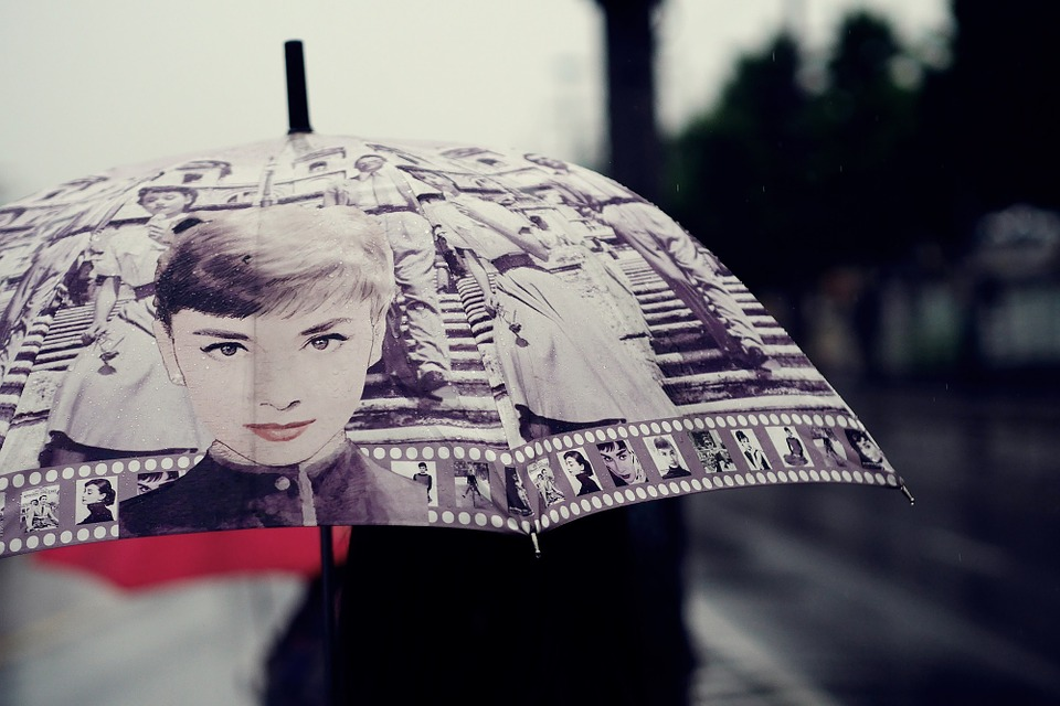 Surviving the spring showers in style audrey hepburn umbrella style etc